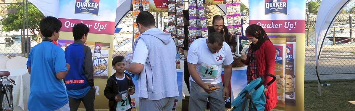 RunQ8 charity program